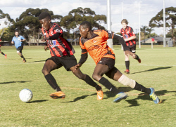 KGM-0035436 © WestPix Goldfields Soccer Association, South Red Strikers and North Scorchers. U 15s.  Picture: Mary Meagher. Strikers Anesu Magwa and Scorchers Sean Nzuwa.