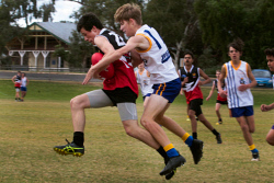 KGM-0040754 © WestPix GFL Juniors Annual Carnival Goldfields v Esperance at Sir Richard Moore Sports Centre Goldfields Campbell Stevens goes in for the tackle on Esperances Riley Wandel. Picture: Tori O'Connor
