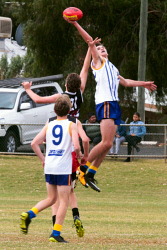 KGM-0040770 © WestPix GFL Juniors Annual Carnival Goldfields v Esperance at Sir Richard Moore Sports Centre Goldfields Jamie Bratton wins the centre bouce against Esperances Connor Fraser. Picture: Tori O'Connor