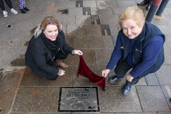 KGM-0041144 © WestPix Chamber of Minerals and Energy manager Rowena Olsen and  Eastern Goldfields Historical Society's Jan Lamont reveal Eileen Joyce as the latest addition to the Walk of Fame on Hannan Street. Picture: Kelsey Reid