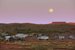 SMI-1400877 © WestPix The full moon rising over the Pannawonica rodeo grounds as the participants set up for the weekend (2009). Picture: Peta Smith
