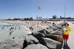 SUN-1401010 © WestPix Surf Life Saving WA trial of drones at Perth beaches. Pictured - SLSWA lifesaving contract services manager Pete Scott with the DJI Phantom 4, just after City Beach was reopened due to a shark alarm. Picture: Daniel Wilkins