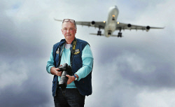 SUN-1403495 © WestPix Plane spotting has become a very popular hobby in the Perth area with people of all ages taking it up. Pictured is Richard Krieder below the flight path on Kalamunda Rd. Picture - Justin Benson-Cooper. The Sunday Times