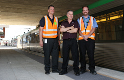 SUN-1403998 © WestPix The Sunday Times is getting a first look at public transport to the new Optus Stadium. Pictured - acting special events co-ordinator Daniel Rocca, Tony Saetta who drove the first train to the station and assistant operations manager for TransPerth trains Murray Rowe. Picture - Justin Benson-Cooper/The Sunday Times