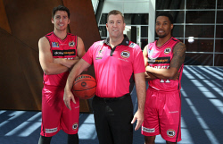 SUN-1404131 © WestPix The Perth Wildcats will be wearing a pink uniform for the first time in next Thursday's home game against Illawarra to help raise money for breast cancer. Pictured is Perth Wildcats coach Trevor Gleeson (c) with players Damian Martin and Bryce Cotton. Picture - Justin Benson-Cooper. The Sunday Times