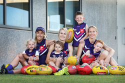 SUN-1404411 © WestPix Fremantle Dockers AFLW players who are mums. At Sunday's match, the trio and their kids will run through the banner to celebrate a 'family day'. Pictured - Lisa Webb with Ollie (2), Dana Hoker with Alice (1) and Jodie White with Joshua and Lucas (5). Picture: Daniel Wilkins