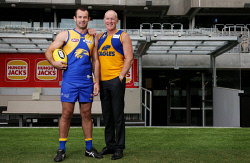 SUN-1404828 © WestPix The West Coast Eagles will play their first match on Sunday against the Sydney Swans at the new Optus Perth Stadium. Pictured is the current West Coast Eagles captain Shannon Hurn with the Inaugural West Coast Eagles captain Ross Glendinning in front of the race where the team will run out on Sunday. Picture - Justin Benson-Cooper/The Sunday Times
