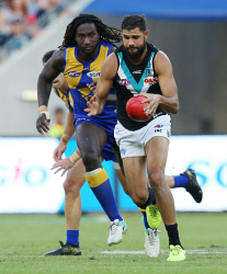 SUN-1404960 © WestPix AFL. West Coast Eagles v Port Adelaide at Optus Stadium in Perth. PIctured - Ports Paddy Ryder is chased by Eagle Nic Naitanui. Picture - Justin Benson-Cooper/ The Sunday Times