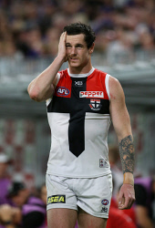 SUN-1405055 © WestPix AFL Round 8 - Fremantle Dockers vs St Kilda Saints at Optus Stadium, Perth. PIctured - St Kilda's Jake Carlisle leaves the field with the trainers after a head knock during the second term. Picture: Daniel Wilkins