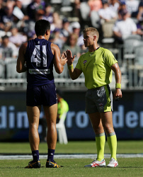 SUN-1405346 © WestPix AFL Round 3 - Gold Coast Suns vs Fremantle Dockers at Optus Stadium, Perth. Pictured- An umpire chats with Fremantle's Bailey Banfield after an altercation with Aaron Hall. Picture: Daniel Wilkins