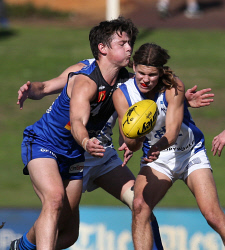 SUN-1405646 © WestPix WAFL - East Perth Royals vs East Fremantle Sharks at Leederville Oval. Pictured - East Fremantle's Corey Robinson gets a handball away under pressure from East Perth's Hamish Brayshaw Picture: Daniel Wilkins