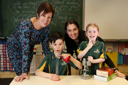 SUN-1405684 © WestPix Melville Primary School has a very vibrant and engaged gifted and talented program. Pictured are students James Carroll (10) and Caitlin O'Neill (6) with principal Betty McNeill and learning support co-ordinator (gifted and talented education) Jane Nolan. Picture - Justin Benson-Cooper / The Sunday Times