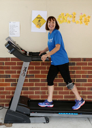 SUN-1405686 © WestPix Jo Penkin is a MS sufferer and is walking 1km a day on her treadmill in lead up to City to Surf. She is aiming for 42km. Pictured is Jo at home. Picture - Justin Benson-Cooper / The Sunday Times