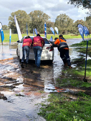 SUN-1405694 © WestPix The Toodyay Lions Football Club and other spectators help to push out the bogged Seven West Media vehicle at Extracts Weir during the Avon Descent. Picture - Toodyay Football Club