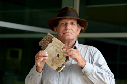 TWA-0052959 © WestPix Blaine Gibson the US wreckage hunter with a new piece of wreckage from MH370. Blaine is pictured with what is believed to  be a piece of the cabin. Picture: Ian Munro The West Australian 06/09/2016