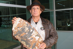 TWA-0053338 © WestPix MH370 evidence - Blaine Gibson with the very significant piece of debris that he will hand to the ATSB in Canberra tomorrow.  Picture: Geoffrey Thomas  The West Australian