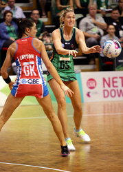 TWA-0053896 © WestPix West Coast Fever's Caitlin Bassett disposes the ball around NSW Swift's Sharni Layton during their ANZ Championship game at Challenge Stadium. Picture: Bill Hatto   The West Australian