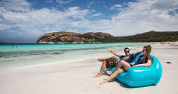 TWA-0064705 © WestPix Backpackers Tom Kossmann from Germany and Esme Conway from the UK enjoy the spectacular view and the white sand of Lucky Bay from the comfort of their blow-up couch. The beach sand from Lucky Bay has been scientifically tested and found to be Australia's whitest beach sand.  Pic Mogens Johansen, The West Australian