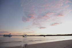 TWA-0071953 © WestPix Early morning light over tranquil Coral Bay. Picture: Stephen Scourfield The West Australian
