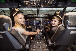TWA-0076471 © WestPix School Holidays: Twins Tiana Chin & Nikolas Chin at the Perth Flight Experience today. Photo by Michael Wilson, The West Australian.