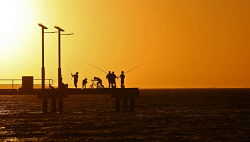 TWA-0080746 © WestPix Anglers try their luck at the Jurien Bay jetty against a spectacular sunset. The rule of thirds have been used in this shot. Picture: Mogens Johansen, The West Australian