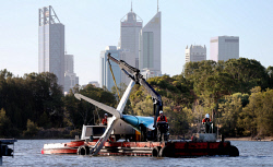 TWA-0080978 © WestPix The tail wreckage of a plane that crashed in Perth Water during Australia Day celebrations is brought ashore at the Department of Parks and Wildlife depot in Victoria Park. PICTURE: NIC ELLIS   THE WEST AUSTRALIAN