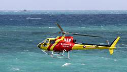 TWA-0082739 © WestPix The surf lifesaving Westpac helicopter over Cottesloe. PIcture: Sharon Smith