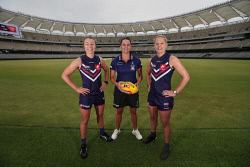 TWA-0083419 © WestPix Fremantle Dockers coach Michelle Cowan, centre, with players Kellie Gibson and Amy Lavell on the turf at the new Optus Stadium. 15 JANUARY 2018 Picture: Danella Bevis The West Australian