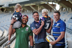 TWA-0084614 © WestPix NRL stars Zane Musgrove, of South Sydney Rabbitohs, Gerard Beale, of New Zealand Warriors, and Kerrod Holland, of Canterbury-Bankstown Bulldogs, with Isla, 5, and Broden Freeman, 1, who are showing off their Billy Slater jerseys at Perth's Optus Stadium.
