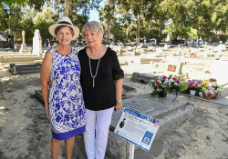 TWA-0085518 © WestPix Leah Hanson (left) and Robynne Nardini, grand-daughters of Paul McGinness - the co-founder and driving force of Qantas at his grave at Karrakatta Cemetary. Picture: Iain Gillespie The West Australian