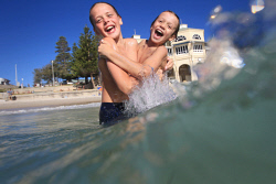 TWA-0085636 © WestPix Lachlan Burt, 10, and brother Jamie Burt enjoy the waves at Cottesloe Beach. 15 FEBRUARY 2018 Picture: Danella Bevis The West Australian