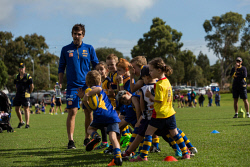 TWA-0088869 © WestPix West Coast Eagles will hold it's annual Rick's Rookies Coaching Clinic for hundreds of kids at Wembley Sports Park, Perth. Pictured is West Coast Eagles midfielder Andrew Gaff playing tunnel ball with kids at the event. Photo: Ross Swanborough. 230418