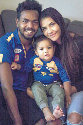 TWA-0090431 © WestPix West Coast Eagles star Willie Rioli is pictured at home with his partner Lucy and their son Martin. Picture: Michael Wilson The West Australian