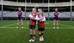TWA-0093135 © WestPix Fremantle Dockers womens AFL players Dana Hooker, left and Kara Donnellan at Optus Stadium with sisters Sophie, left, aged seven and Mia Jennings, junior footballers with the Kardinya Kittens. The State government has announced funding for female changerooms throughout the State. PICTURE NIC ELLIS   THE WEST AUSTRALIAN