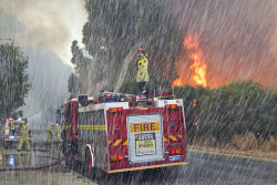 WAN-0000208 © WestPix Atwell fire . A waterbomber covers the area with foam after a fly-by.  Picture: Simon Santi/The West Australian 03/02/2014 ######