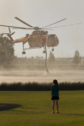 WAN-0000209 © WestPix Atwell fire . Residents watch on as Air-Crane helicopters fly overhead.  Picture: Simon Santi/The West Australian 03/02/2014 ######
