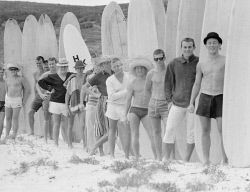 WAN-0003756 © WestPix 'Beachniks' lined up at Yallingup Beach with their surfboards. Circa 1960.  WAN Historical Archive