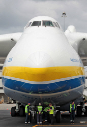 WAN-0026595 © WestPix The Antonov An-225 Mriya - the largest aircraft in the world and the only one of its type - lands at Perth Airport on Runway 21. Airport workers are dwarfed by the Antonov. 15 MAY 2016 Picture: Danella Bevis The West Australian