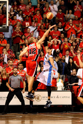 WAN-0029479 © WestPix Perth Wildcats vs New Zealand Breakers: Grand Final Game 2. 20/04/2012. Challenge Stadium. Wildcats' forward Shawn Redhage looms over Breakers' guard CJ Bruton to block his last second shot and clinch the win for the Wildcats. Photo: TRAVIS ANDERSON
