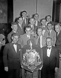 "WAN-0031741 © WestPix CRICKET SHIELD PRESENTATION. GROUP SHOT OF CRICKETERS HOLDING SHIELD. The victorious Sheffield Shield team. L-R Back: Basil Rigg, Allan Edwards and Tom O'Dwyer. Third row: Charlie Puckett, Wally Langdon, Morgan Herbert, Laurie Bandy, Ken Cumming and Gwilym ""Glyn"" Kessey. Second row: George Robinson (VC) and Dave Watt. Front: Keith Carmody (C) and D"