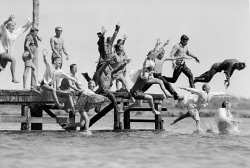 WAN-0031814 © WestPix CHILDREN JUMPING OF THE JETTY FULLY CLOTHED AT THE BELMONT SWIMMING CLUB HEADQUARTERS. IT IS A REQUIREMENT OF THE COURSE TO KNOW HOW TO SWIM WHILE WEIGHED DOWN WITH CLOTHING. 2 FEBRUARY 1963.