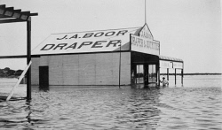WAN-0031844 © WestPix THE CARNARVON FLOODS IN 1908. WATER IS WAIST DEEP AT THE J.A. BOOR DRAPER & OUTFITTER STORE.